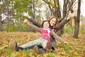 Free Two Sisters Sitting On The Leafs In The Park. Stock Photo - 16883490