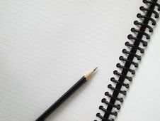 Free Black Pencil On Open White Paper Stock Photo - 16880580