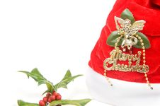 Red Santa Claus Hat And Holly Berry Royalty Free Stock Photo