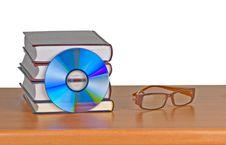 Free Books, Eyeglasses, And DVD Royalty Free Stock Photo - 16882905