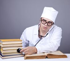 Free Young Male Doctor Studying Medical Books Stock Image - 16882941