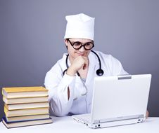 Young Doctor With Books And Computer. Royalty Free Stock Photography