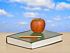 Free Apple And Book On Desk Stock Photo - 16883350
