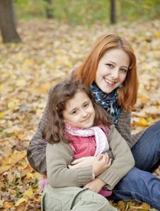 Free Two Sisters Sitting On The Leafs In The Park. Royalty Free Stock Image - 16883376