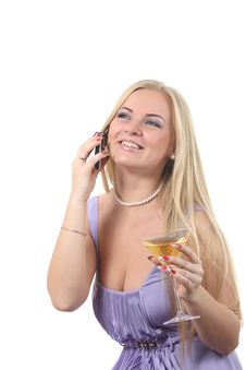 Blond In A Dress Drink Martini And Speak Phone Royalty Free Stock Images