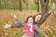 Free Two Sisters Sitting On The Leafs In The Park. Royalty Free Stock Photo - 16883405