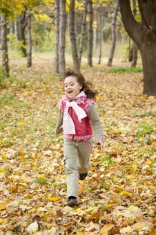 Free Cute Running Girl In Autumn Park. Royalty Free Stock Photos - 16883538