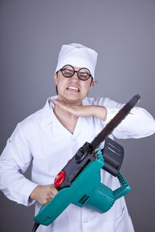 Free Crazy Doctor With Portable Saw. Stock Photography - 16883562