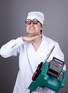 Free Crazy Doctor With Portable Saw. Royalty Free Stock Photography - 16883567