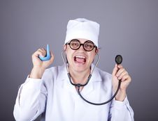 Free Crazy Doctor With A Stethoscope And Enema. Royalty Free Stock Photo - 16883635