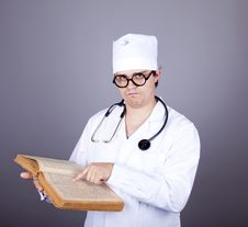 Free Young Doctor With Book. Royalty Free Stock Photography - 16883667