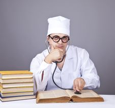 Young Male Doctor Studying Medical Books Royalty Free Stock Image