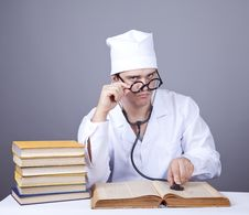 Young Male Doctor Studying Medical Books Royalty Free Stock Photos