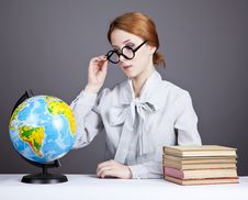 Free The Young Teacher In Glasses With Books And Globe Royalty Free Stock Photography - 16883957