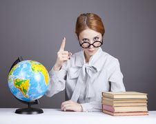 Free The Young Teacher In Glasses With Books And Globe Stock Photography - 16883962