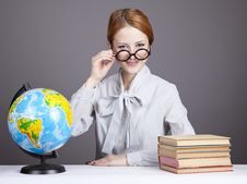 Free The Young Teacher In Glasses With Books And Globe Stock Images - 16883964