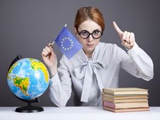 Free The Young Teacher In Glasses With Books And Globe Stock Photo - 16883980