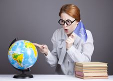 Free The Young Teacher In Glasses With Books And Globe Royalty Free Stock Photo - 16883995