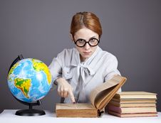 Free The Young Teacher In Glasses With Books And Globe Stock Image - 16884041