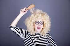 Free Surprised Girl With Comb. Stock Images - 16884384