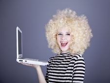 Free Portrait Of Funny Girl In Blonde Wig With Laptop. Stock Images - 16884584