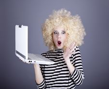 Free Portrait Of Funny Girl In Blonde Wig With Laptop. Stock Photography - 16884612