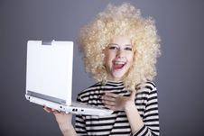 Portrait Of Funny Girl In Blonde Wig With Laptop. Royalty Free Stock Photography