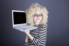 Portrait Of Funny Girl In Blonde Wig With Laptop. Stock Photography