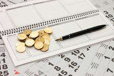 Free Sheets Of A Calendar With Coins And A Notebook Stock Photo - 16885990