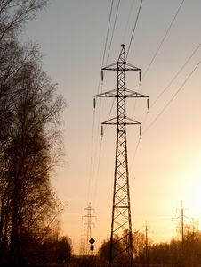 Electricity Pylons And Lines At Dusk. Stock Photos