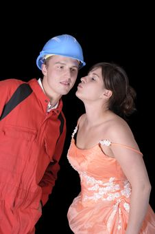 Free Beauty In Evening Gown Kissing A Manual Worker Royalty Free Stock Photography - 16890537