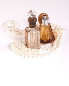 Free TWO PERFUME BOTTLES AND PEARLS Royalty Free Stock Photos - 16890828