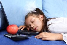Tired Girl Sleeping At Laptop Stock Images