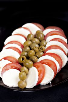 Mozzarella, Tomatoes And Olives Stock Photos