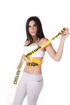 Free Woman Sports Bra Caution Tape Royalty Free Stock Photography - 16892927