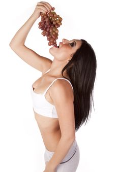 Free Woman Standing Putting Grapes In Mouth Royalty Free Stock Photo - 16893035