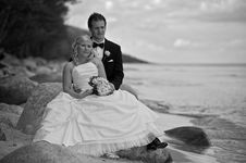 Free Wedding Couple On Stony Beach Royalty Free Stock Image - 16896986