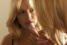 Free Woman Applying Lipstick In Mirror Royalty Free Stock Images - 16897539