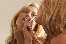 Free Woman Applying Lipstick In Mirror Royalty Free Stock Image - 16897546