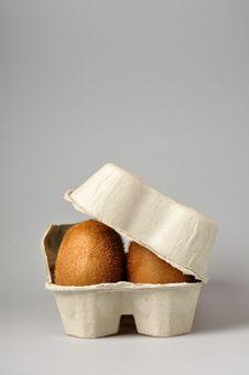 Kiwi In The Eggs Tray Royalty Free Stock Photography