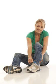 Free Woman Tying Shoe Stock Photos - 16897923