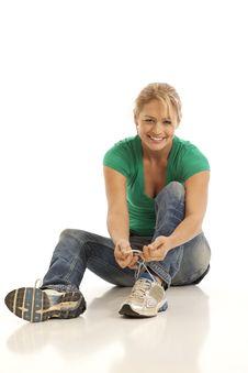 Free Woman Tying Shoe Royalty Free Stock Photos - 16897928