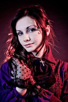 Portrait Of A Goth Girl In A Gray Backgorund