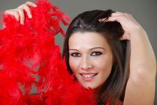 Free Beautiful Girl Holding Red Feathers Stock Photo - 16898160