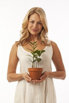 Woman Holding Potted Plant Stock Photos