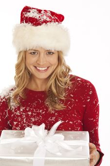 Free Woman In Santa Hat Holding Gift Royalty Free Stock Images - 16898299