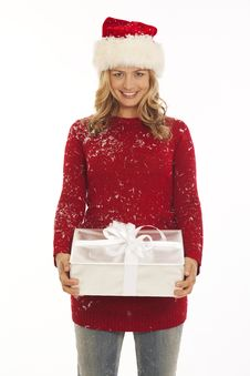 Free Woman In Santa Hat Holding Gift Royalty Free Stock Photos - 16898318