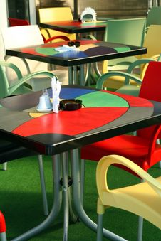 Free Colored Tables And Chairs At Cafe Royalty Free Stock Images - 16898939