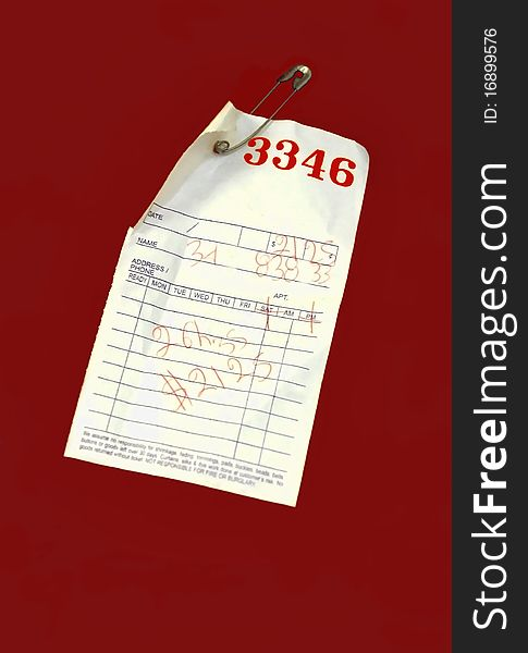 Red Pick-Up ticket on Laundry Bag