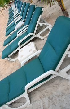 Row Of Green Beach Chairs Royalty Free Stock Images